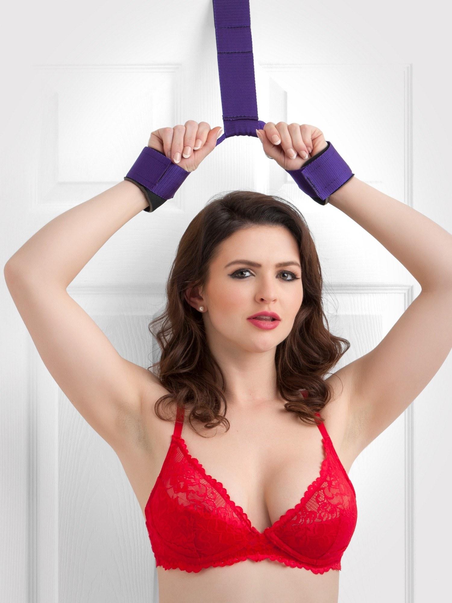 a model using the Purple Reins Over-the-Door Restraint