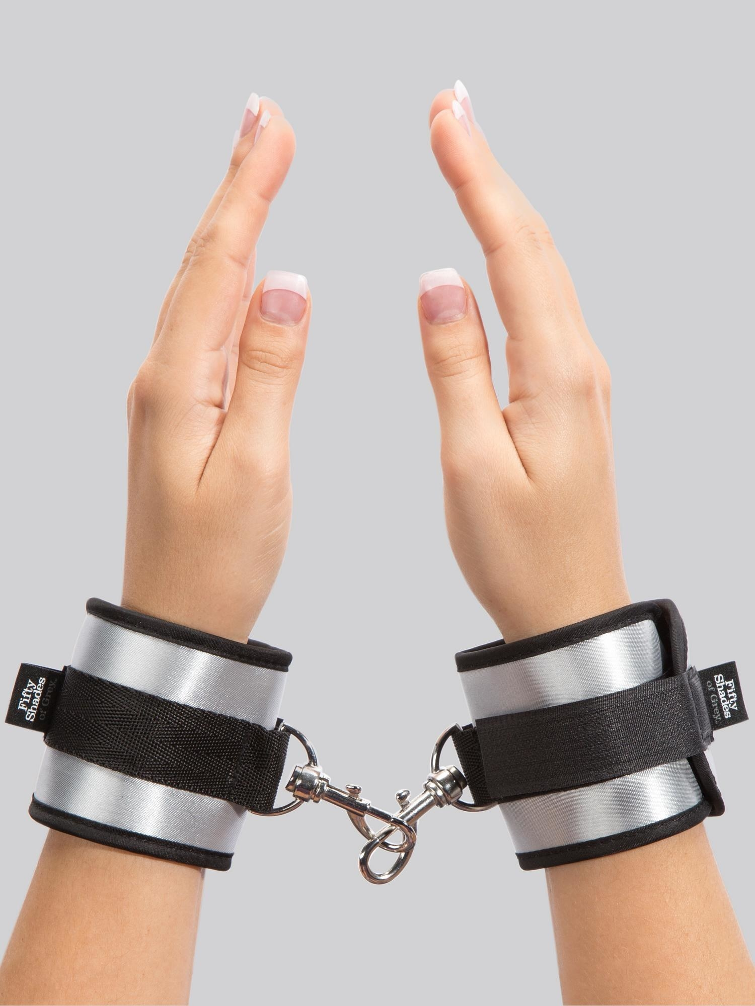 a model's hands in the Fifty Shades of Grey Totally His Soft Handcuffs
