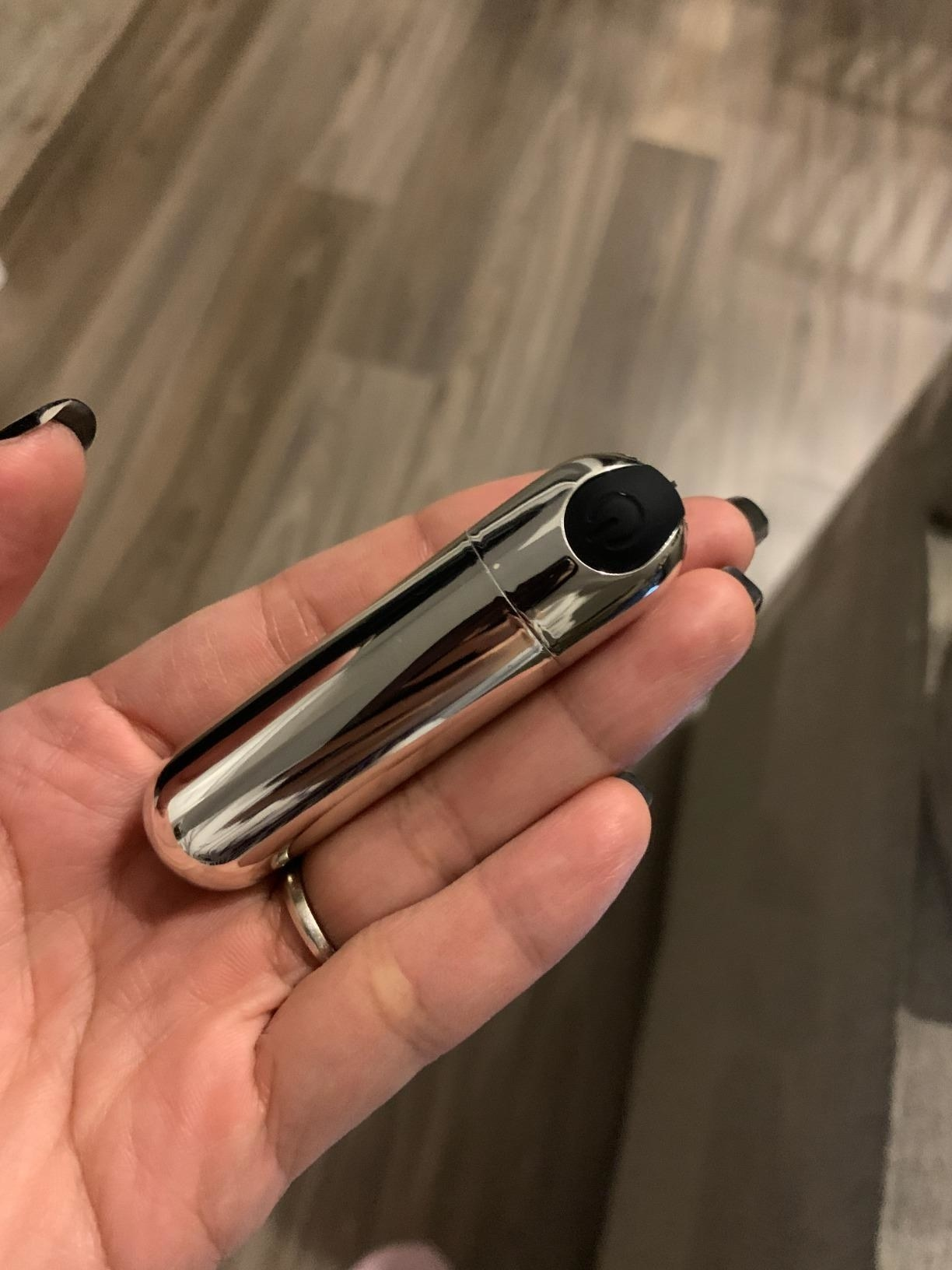 reviewer image of the silver bullet vibrator in the palm of a customer's hand