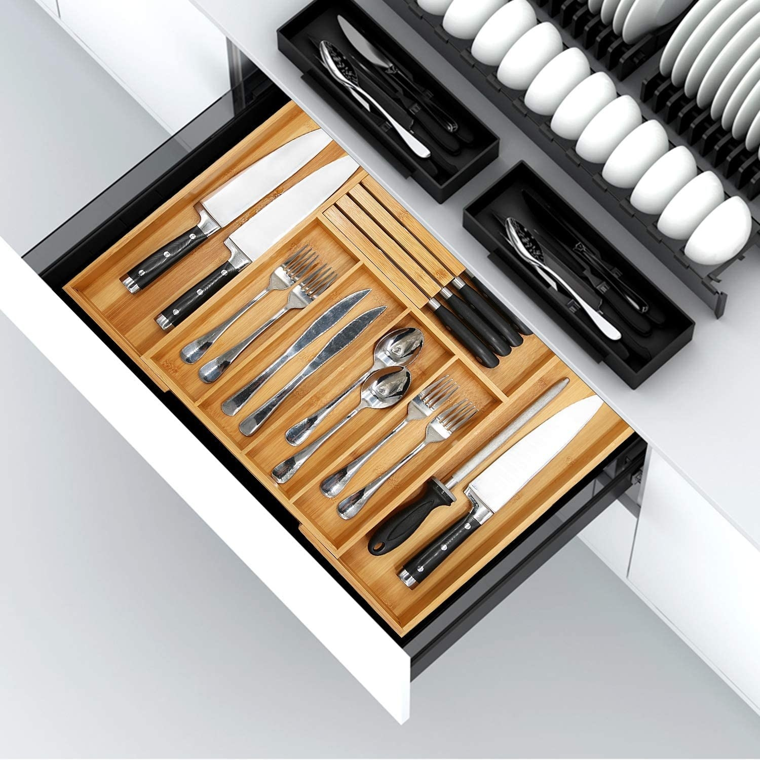 Several knives, forks, and spoons inside the organizer
