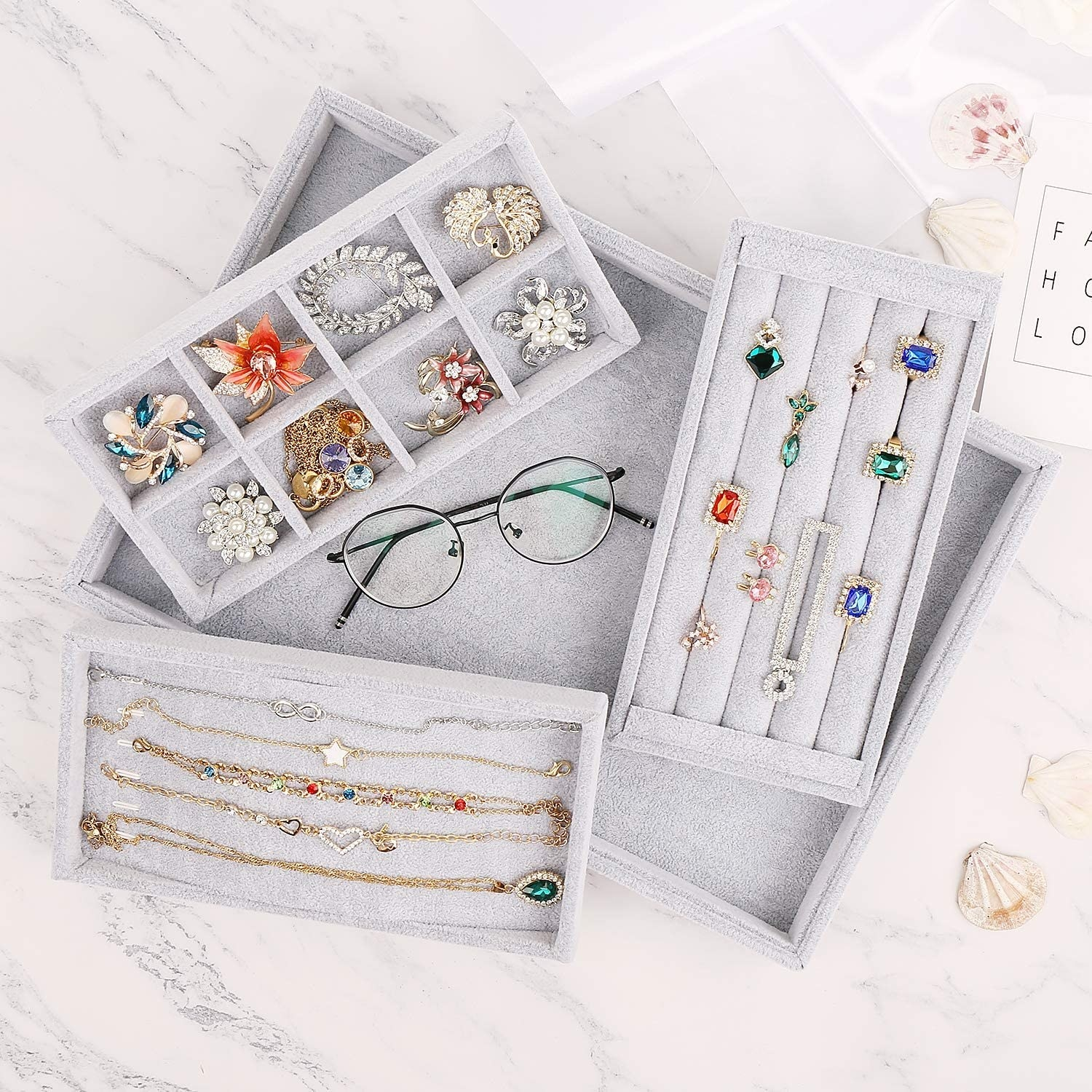 Several pieces of jewellery in the boxes