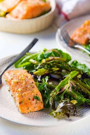 A plate of salmon with greens.