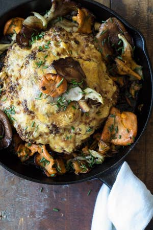 A roasted cauliflower with wild mushrooms.