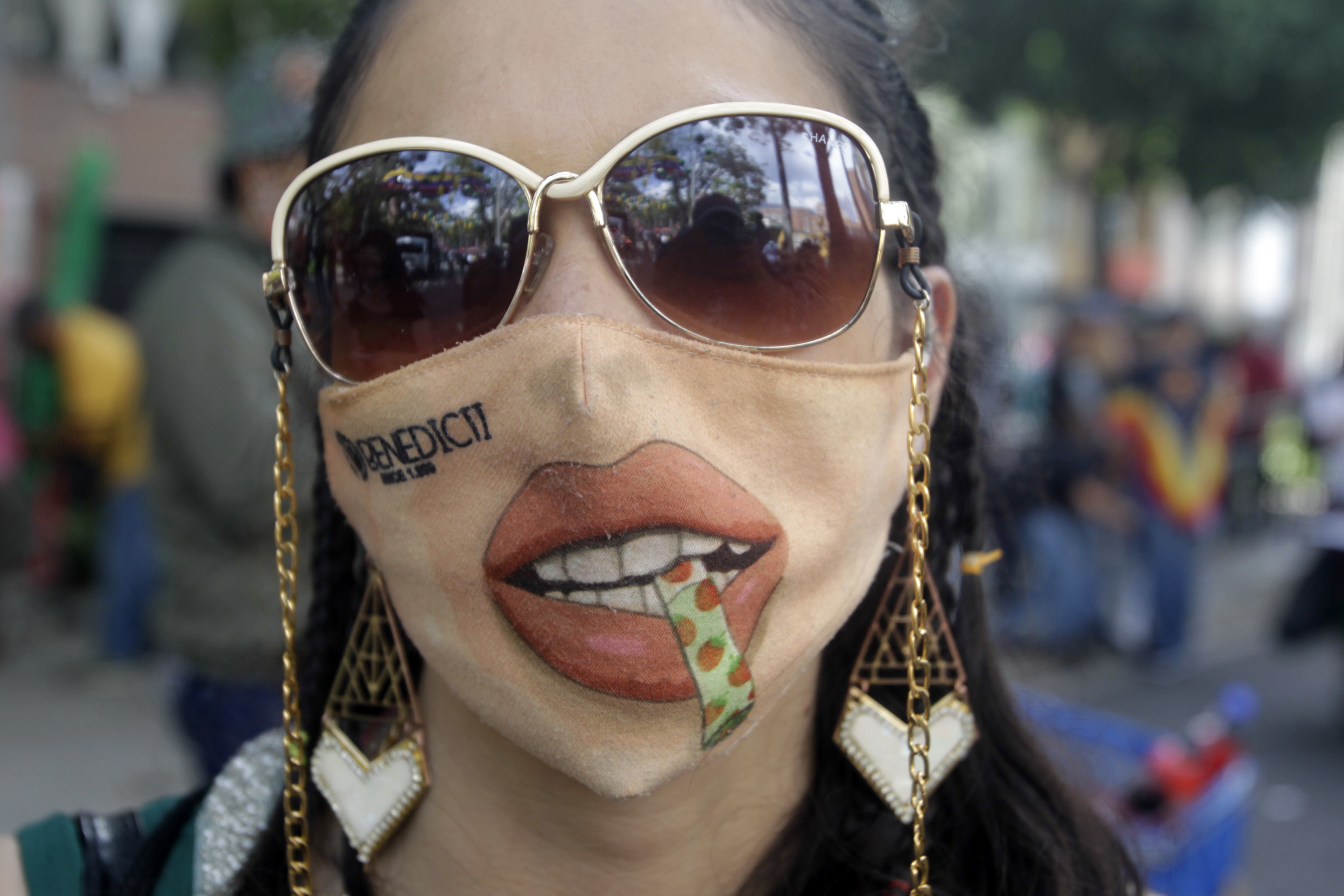 Colombian woman wears joint themed face mask.