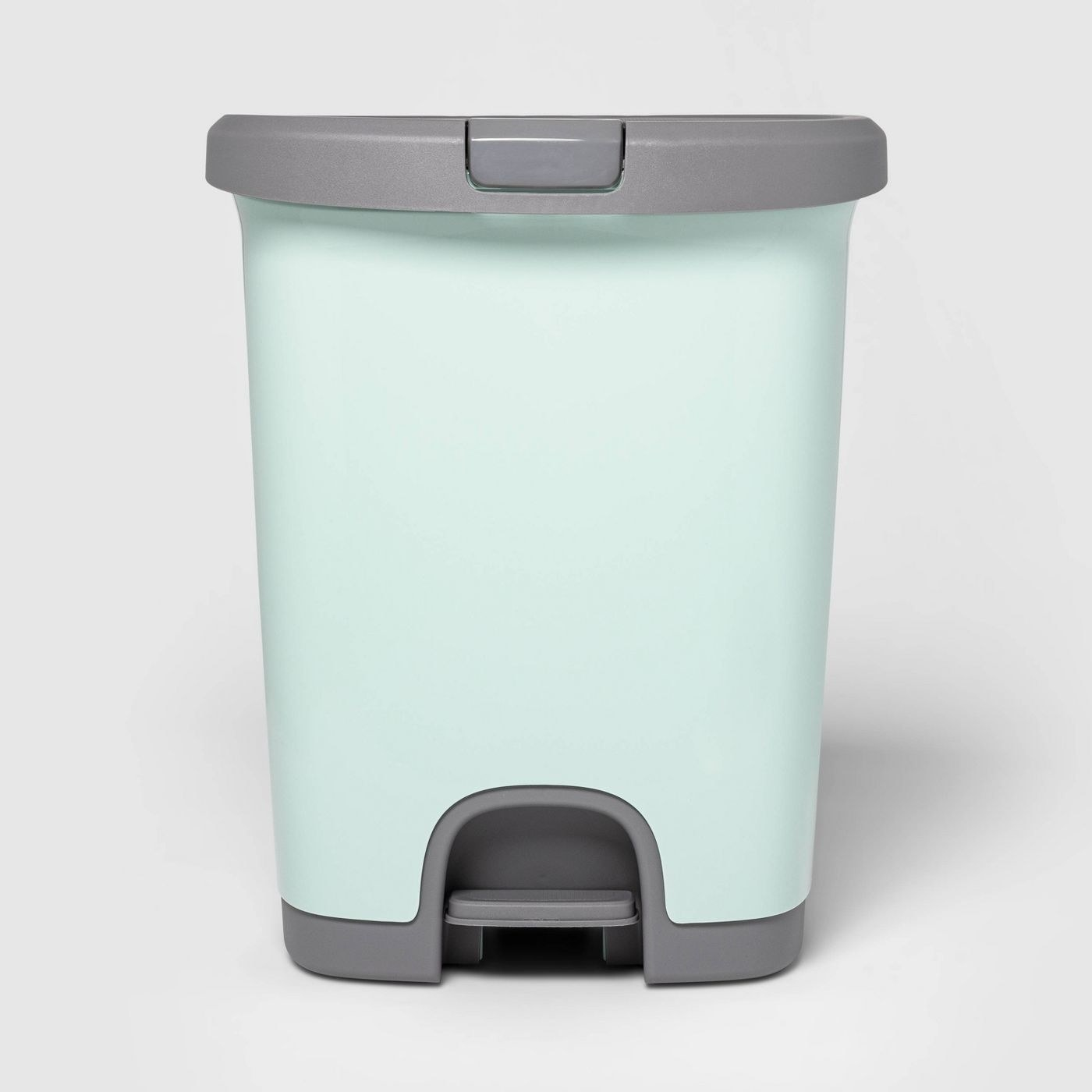 The mint green trash can