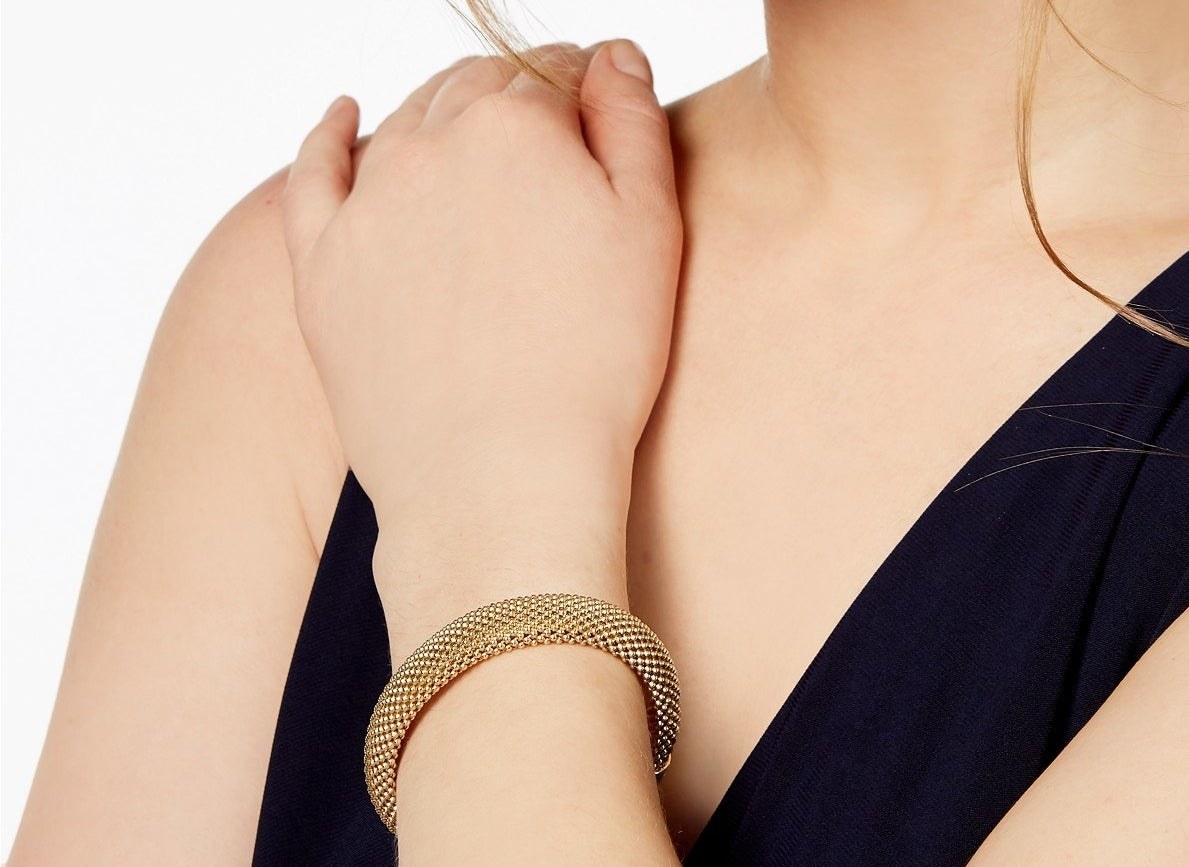 Model wearing the yellow gold bracelet