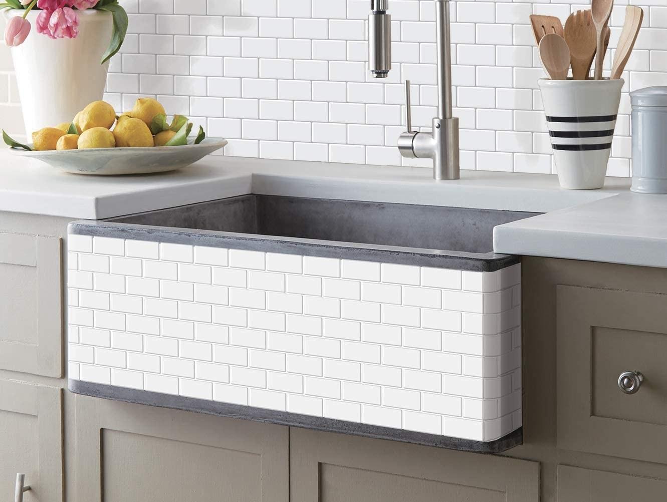 A kitchen back splash covered in the tile sheets