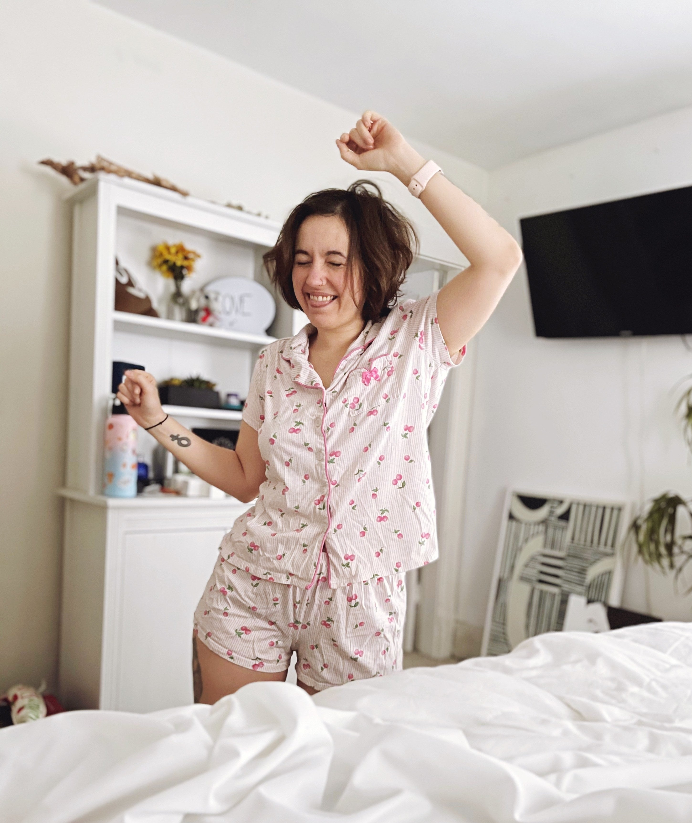 Person is dancing next to a bed