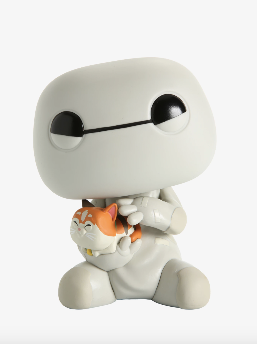 the Baymax figure happily cuddling Mochi the cat