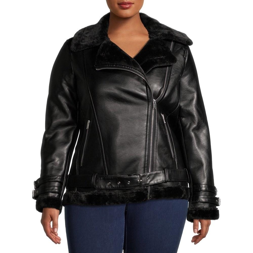 model wears black faux fur lined black leather jacket