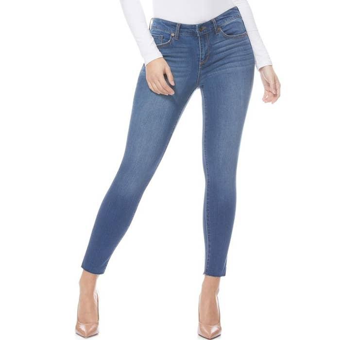 model wears medium wash skinny jeans