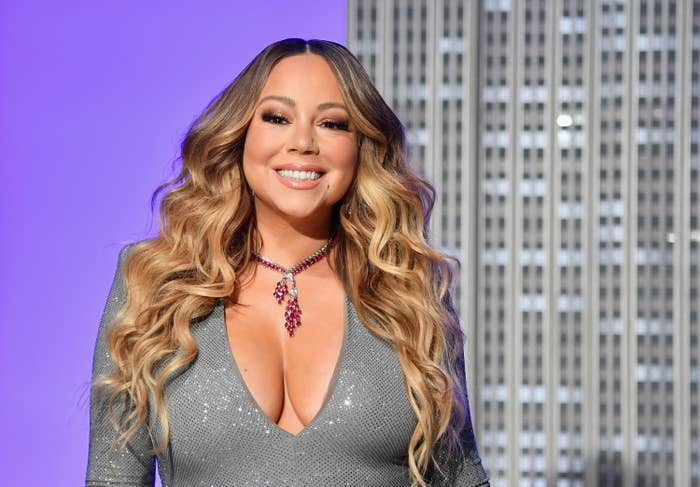 """US singer Mariah Carey participates in the ceremonial lighting of the Empire State Building in celebration of the 25th anniversary of """"All I Want For Christmas Is You"""" on December 17, 2019 in New York City"""