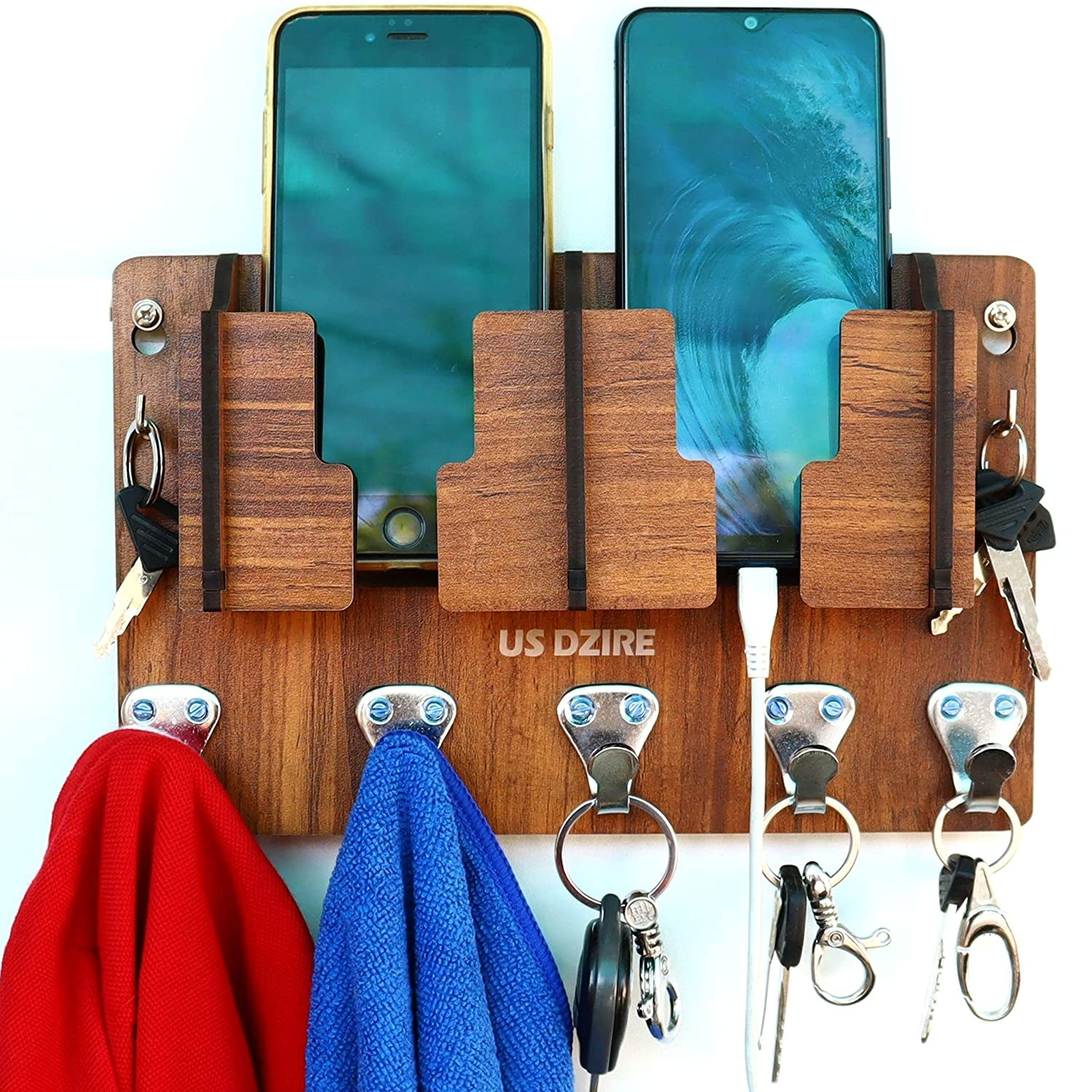 A brown MDF wall organiser with keys, napkins and two phones.