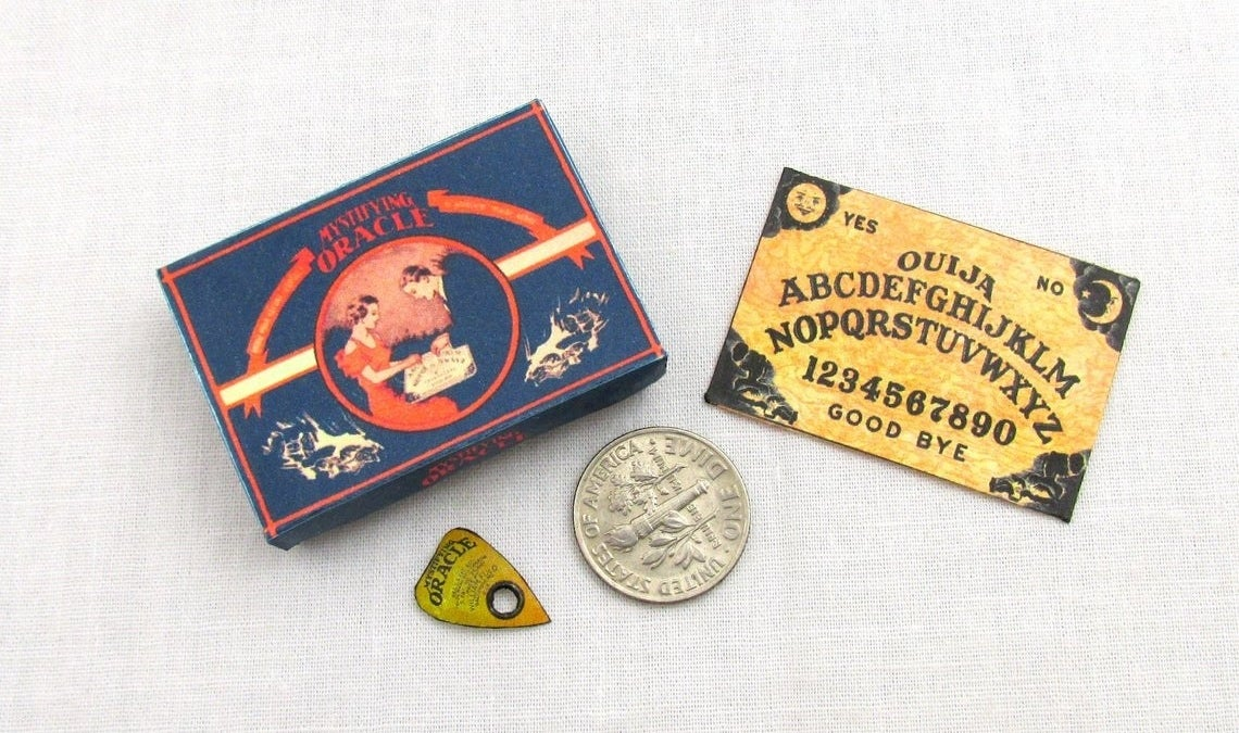 small oujia board with box and planchette
