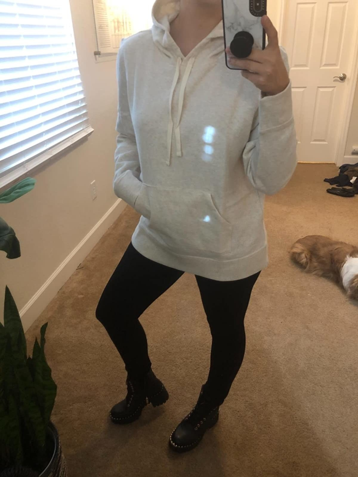 Reviewer wearing white Amazon Essentials pullover hoodie