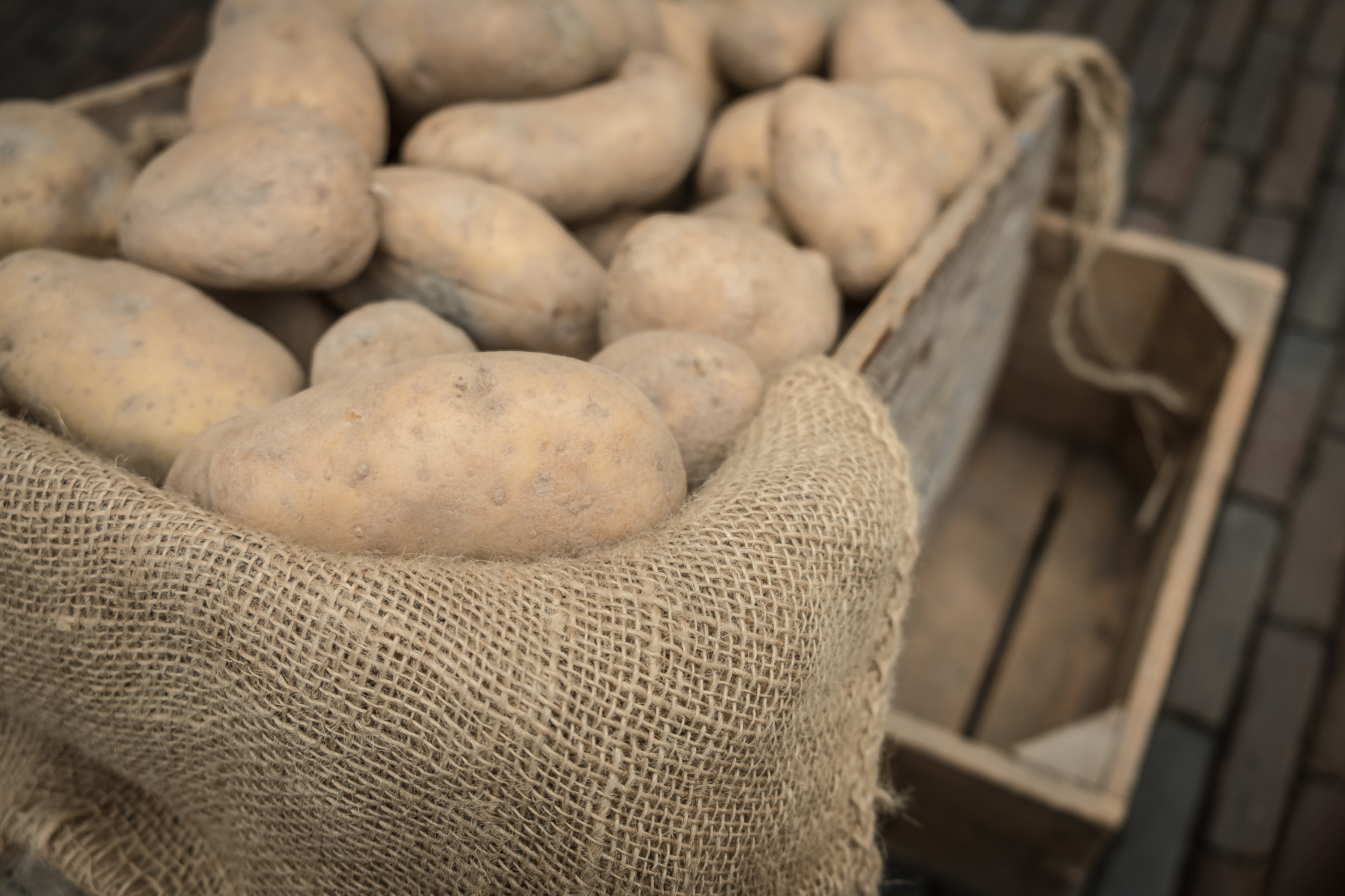 Raw potatoes in a crate