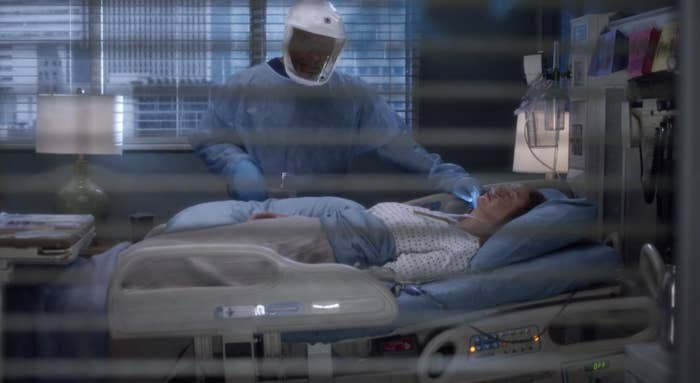 Meredith in a hospital bed and Richard checking her