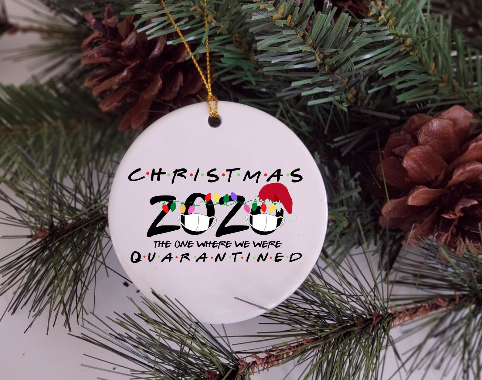 the ornament on a tree that says christmas 2020 the one where we all quarantined