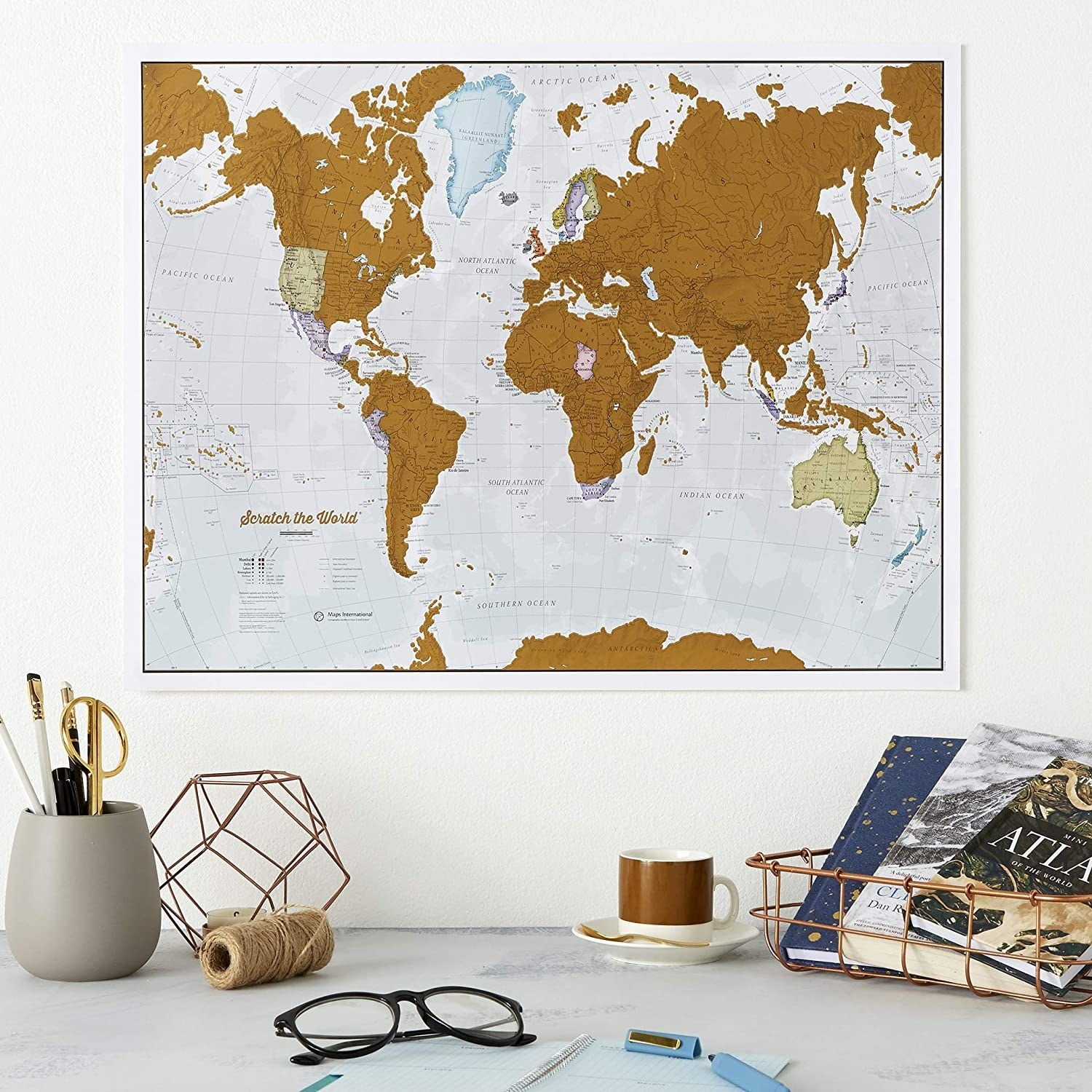 The world map hanging on a wall