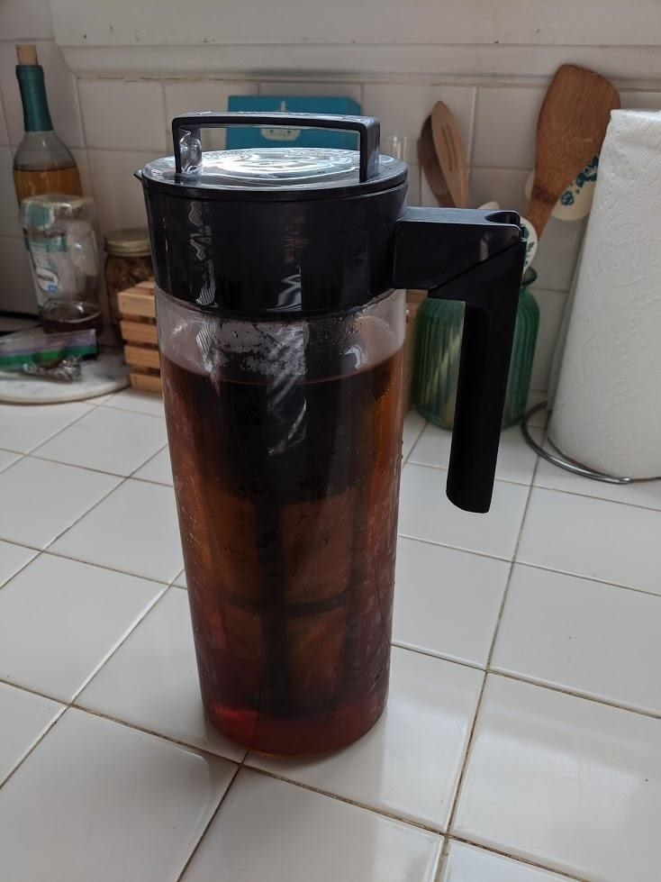 reviewer image of the takeya cold brew maker full of coffee