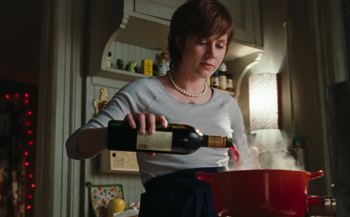 "Julie from ""Julie & Julia"" pouring wine in a pot in her small kitchen"
