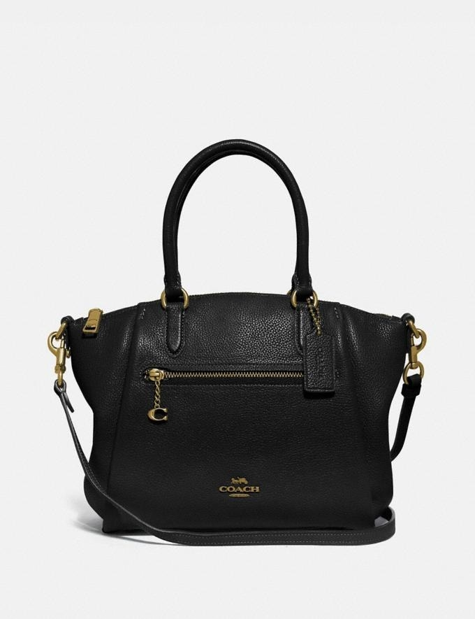 a black satchel with gold accents and the coach logo