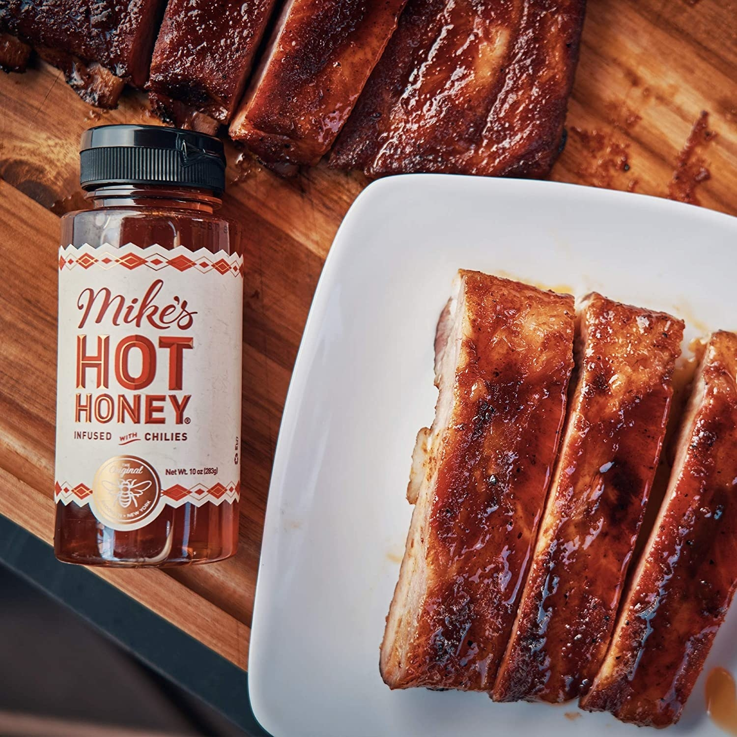 bottle of Mike's Hot Honey next to ribs