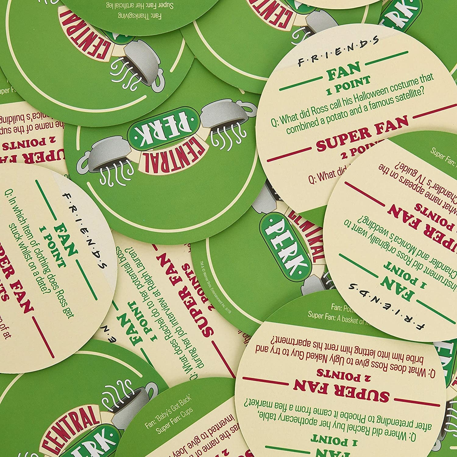 pile of round coasters with different friends trivia questions