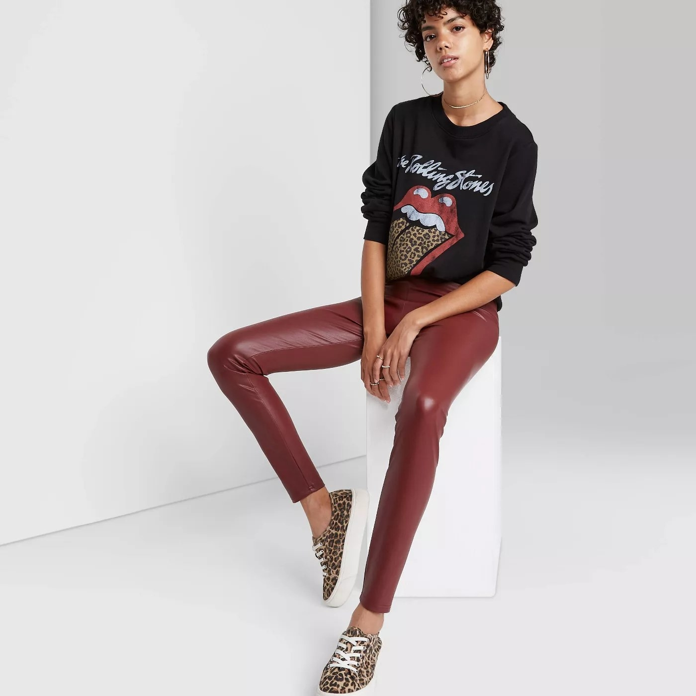 Burgundy leather leggings paired with t-shirt and cheetah shoes