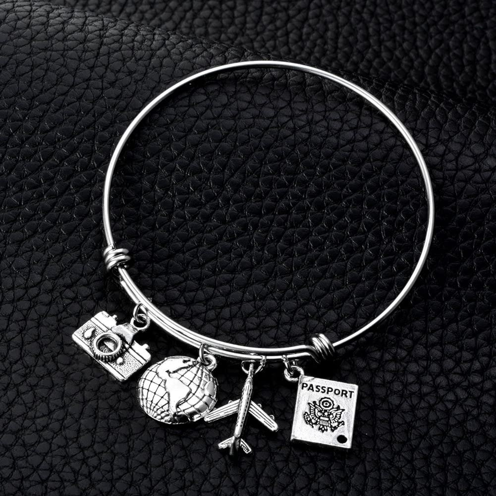 The silver bracelet with passport, plane, globe, and camera charms