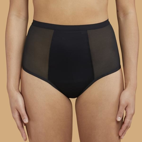 A model wearing the black Super Hi-Waist underwear which have mesh sides