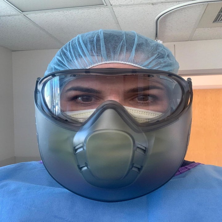 Reviewer  pic wearing a mask and a full face mask, showing how it's not fogging up because of the spray