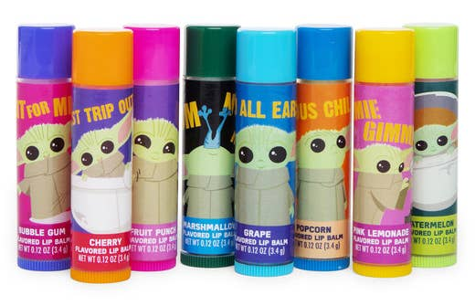 Eight lip balms in different colors with cartoon images of Baby Yoda on them