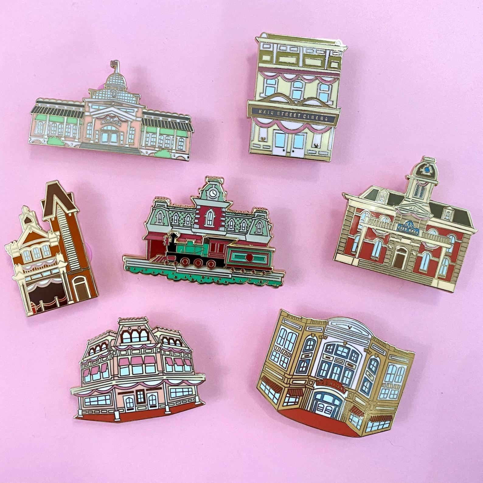 an array of disney world pins