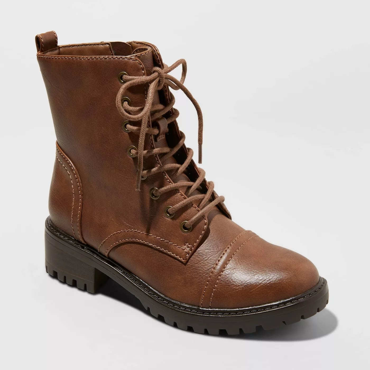 Short brown boots with laces. Sole is black.