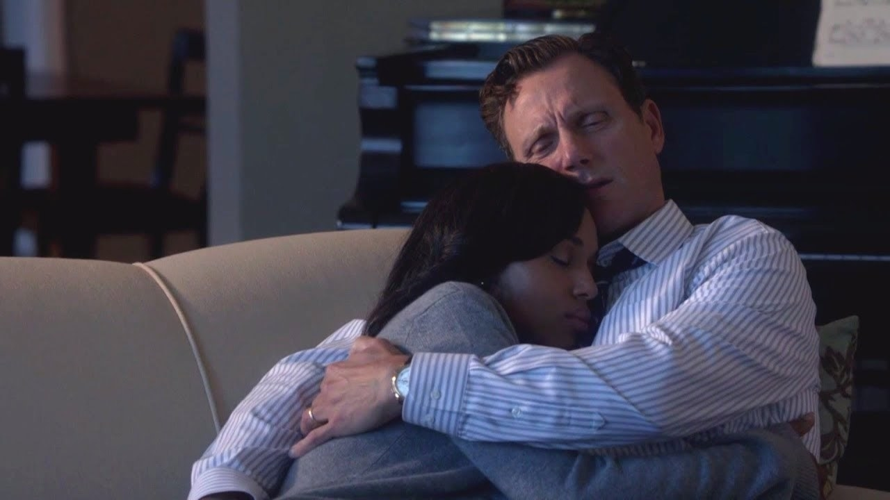 Fitz holding Olivia in his arms.
