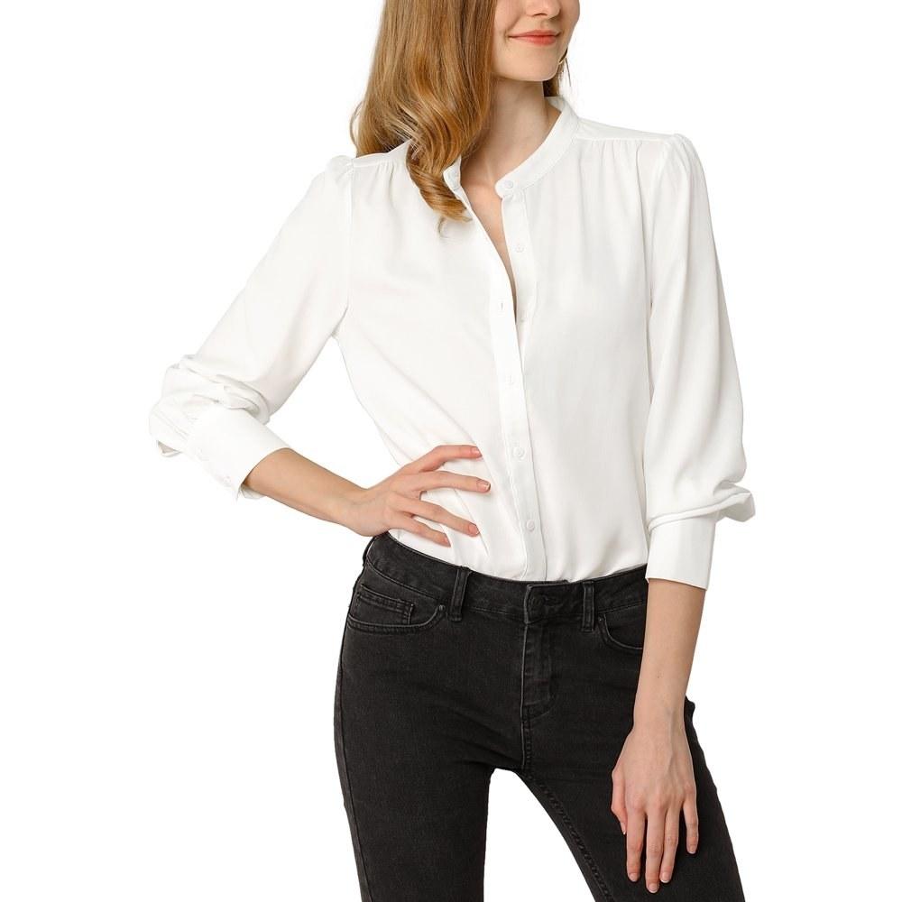 model wears button down white blouse