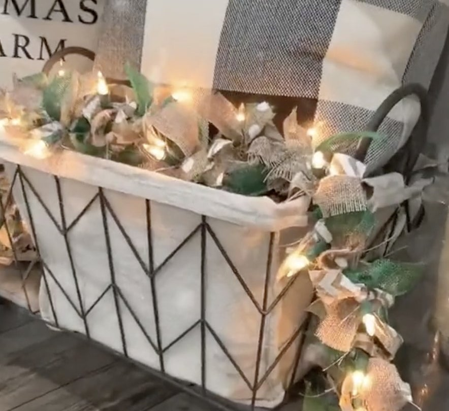 A basket filled with lights and bows
