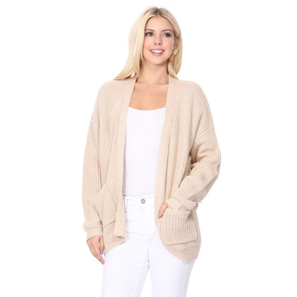 model wears oatmeal colored chunky waffle knit cardigan