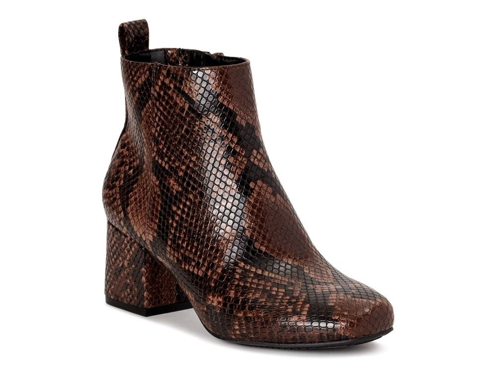 snake print boots in black and brown faux leather