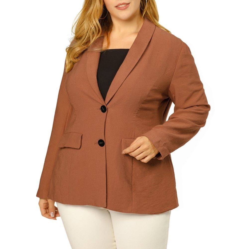 model wears buttoned, camel brown blazer