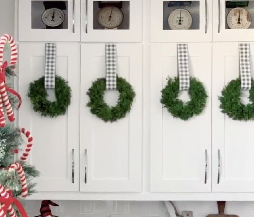 Kitchen cabinets with wreaths hanging
