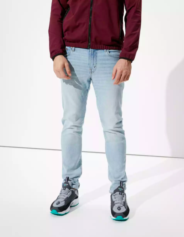 a model wearing the pants with a red sweater