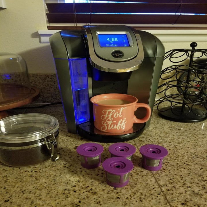 A reviewer's photo of their Keurig machine and four reusable K-cups