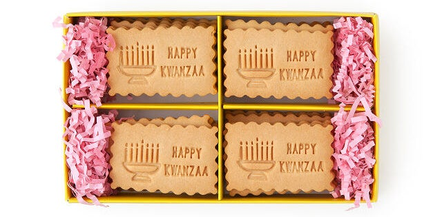 The shortbread cookies which feature a kinara and the words happy kwanzaa