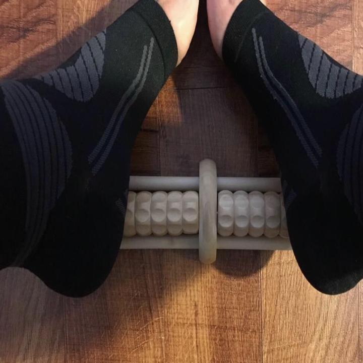 feet using massager