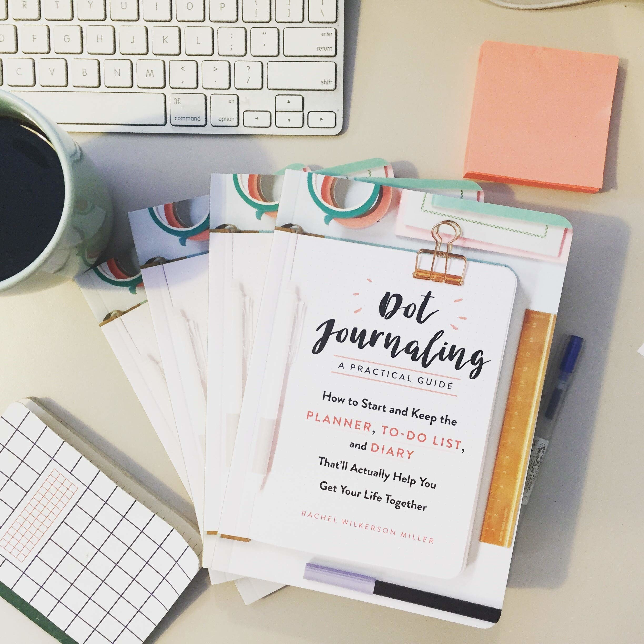 Three dot journaling guides on a desk