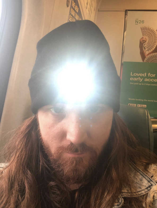 Person wearing LED light beanie