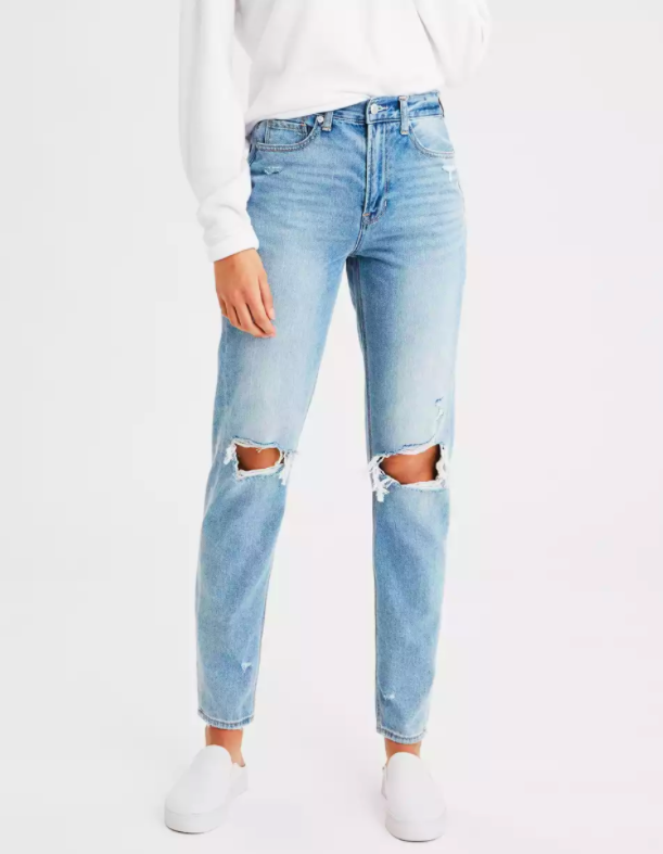 a model wearing the mom jeans in cool classic wash