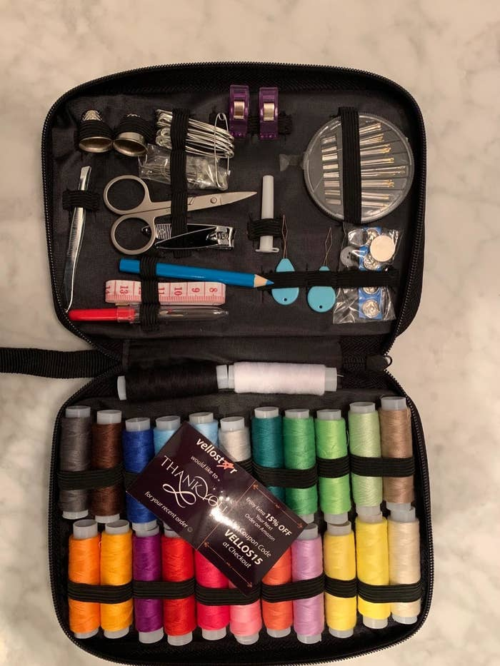 A reviewer photo of the open sewing kit in its included case